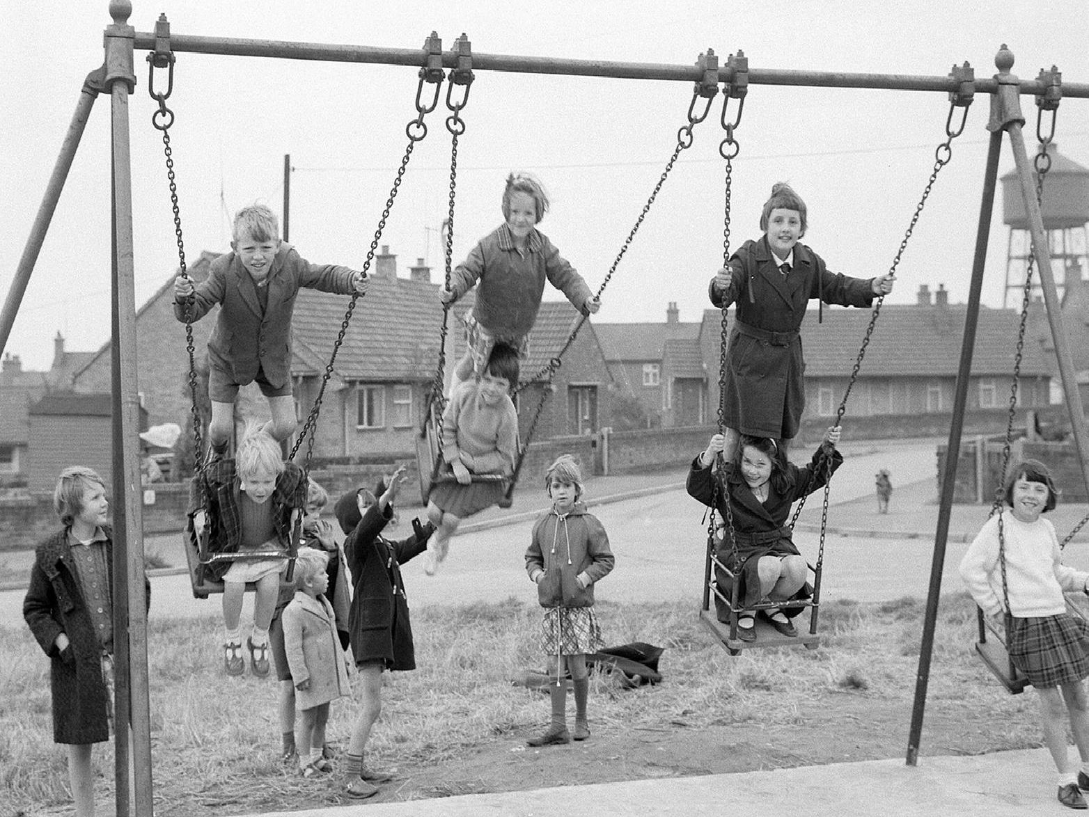 Enjoying having ago on the swings.