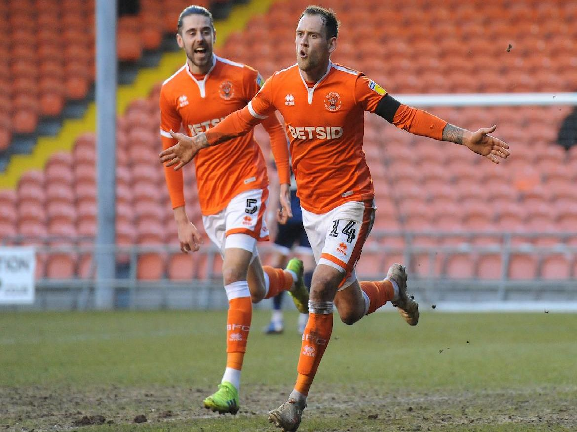 Harry Pritchard celebrates after wrapping up the win for Blackpool two minutes from time