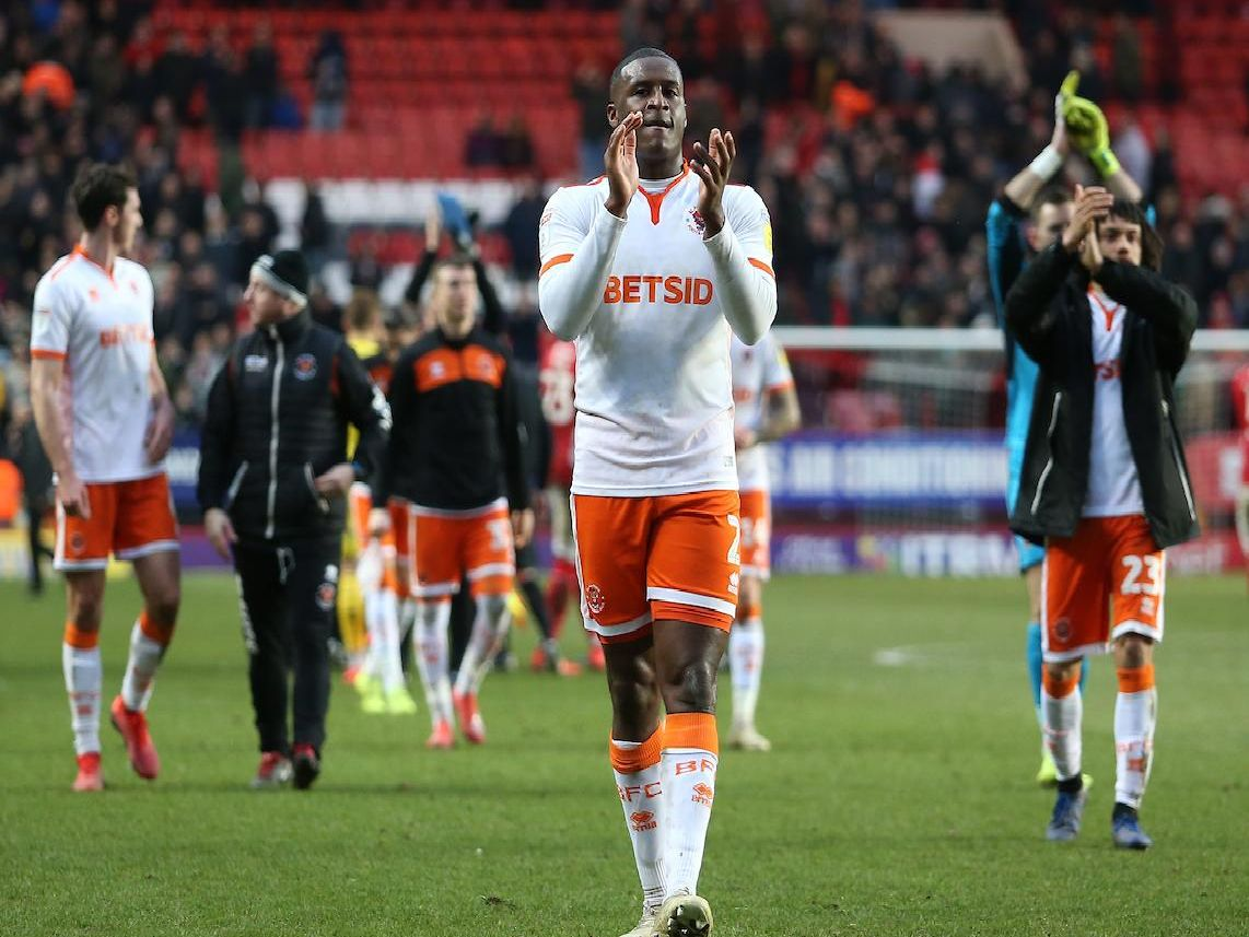 Donervon Daniels applauds the Blackpool fans at full time
