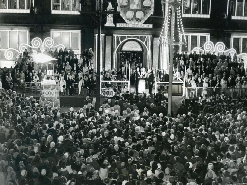 The crowds gather to watch Gracie Fields switch on the lights in 1964