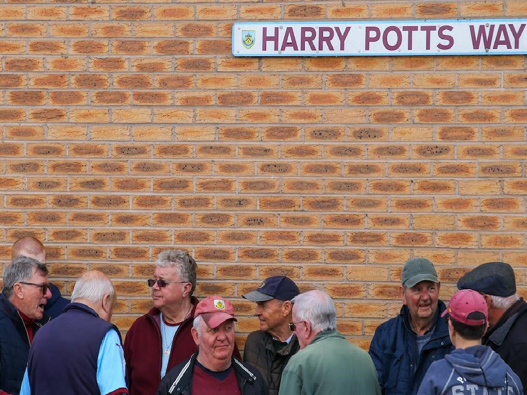 Clarets fans cheer on the team against Arsenal