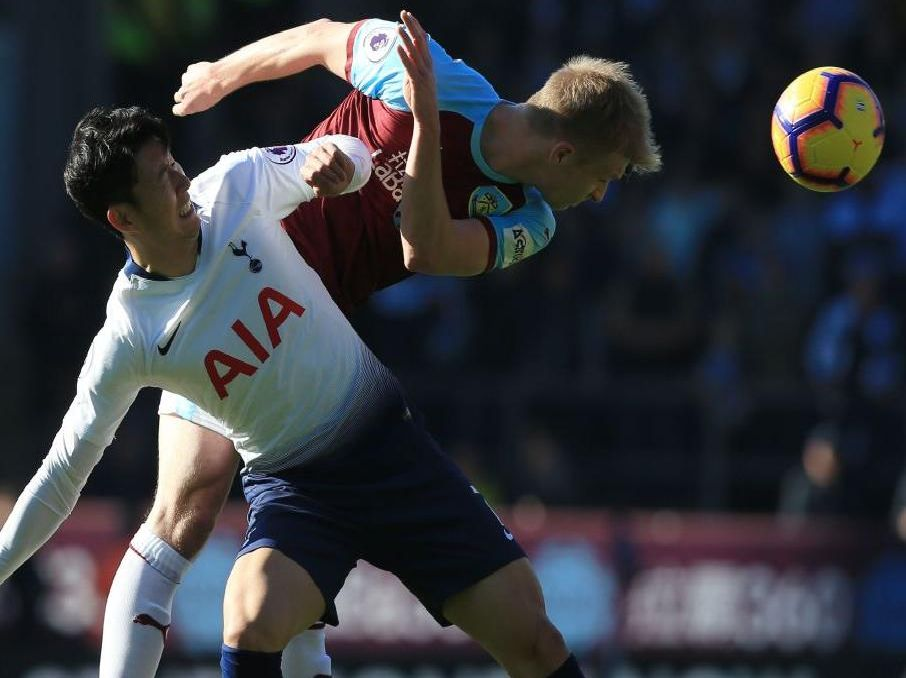 Burnley's Ben Mee beats Tottenham forward Heung-Min Son to the ball at Turf Moor