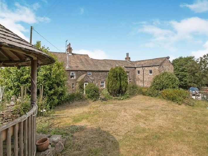 A gorgeous six-bedroom farmhouse, this Burnley property is on the market with GetAnOffer with price available on application.