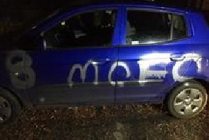 The car was sprayed with paint
