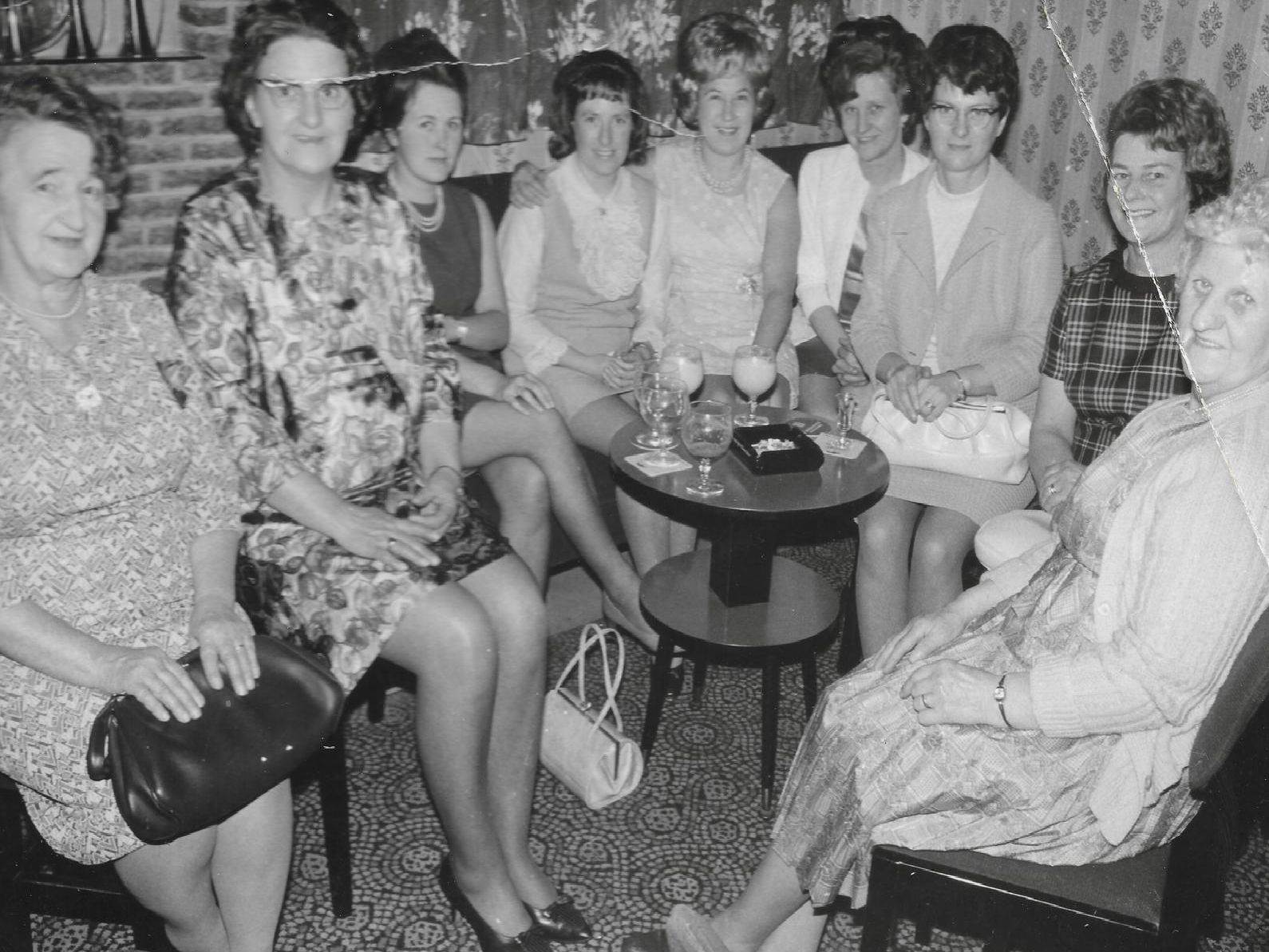 1960s: This happy bunch of ladies are enjoying their presentation evening at the Redgate Pigeon Club in Mansfield. Picture courtesy of Keith Biggs. Do you recognise anyone?