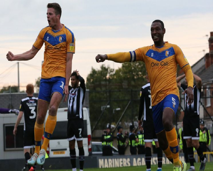 Mansfield Town defender Conor Shaughnessy and Krystian Pearce celebrate the injury-time dramatic winner.