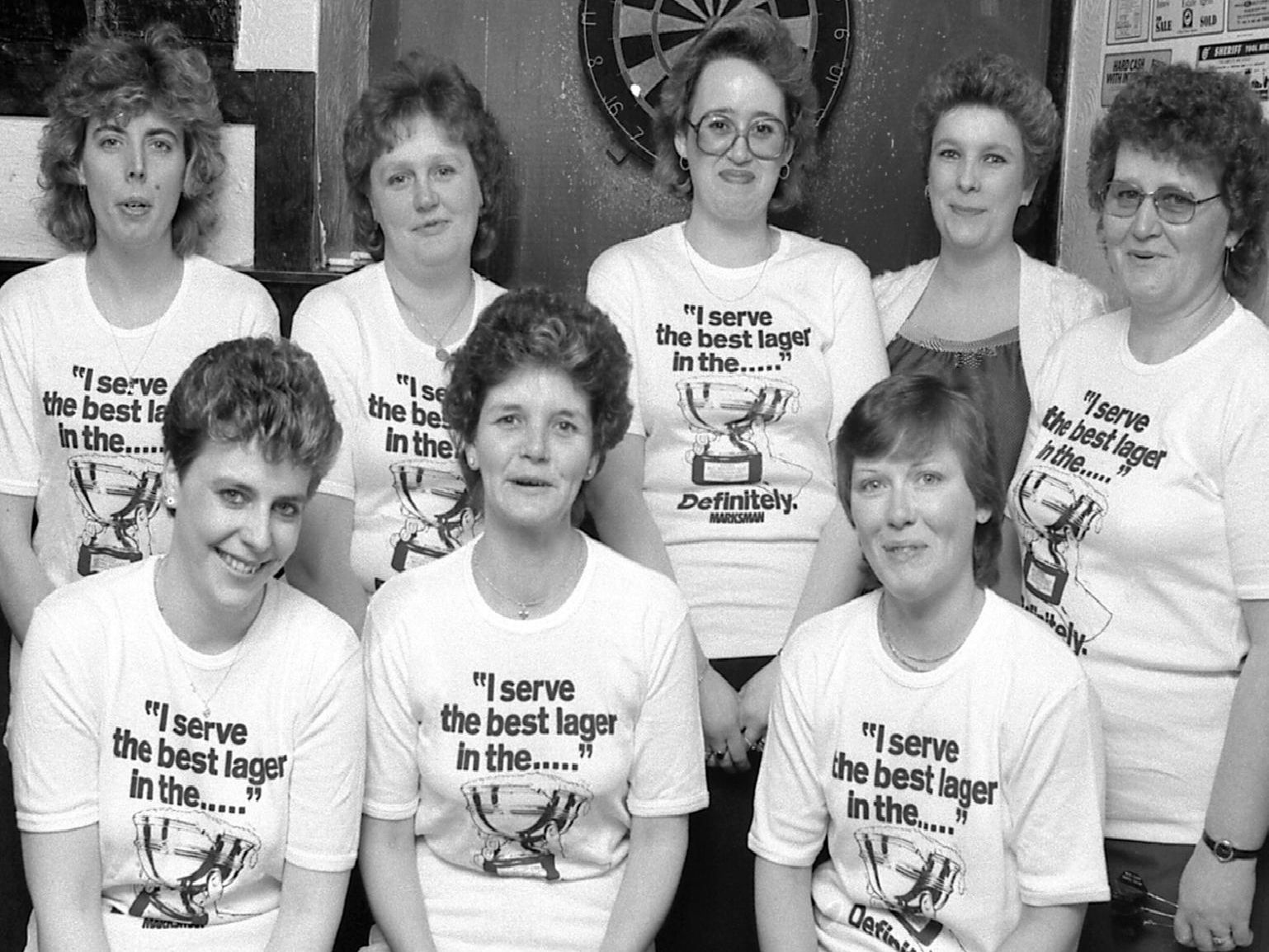 1986: This smiley bunch look ready to win their next match, they play for Bridge Taverns ladies darts team. Did you play for this pub?