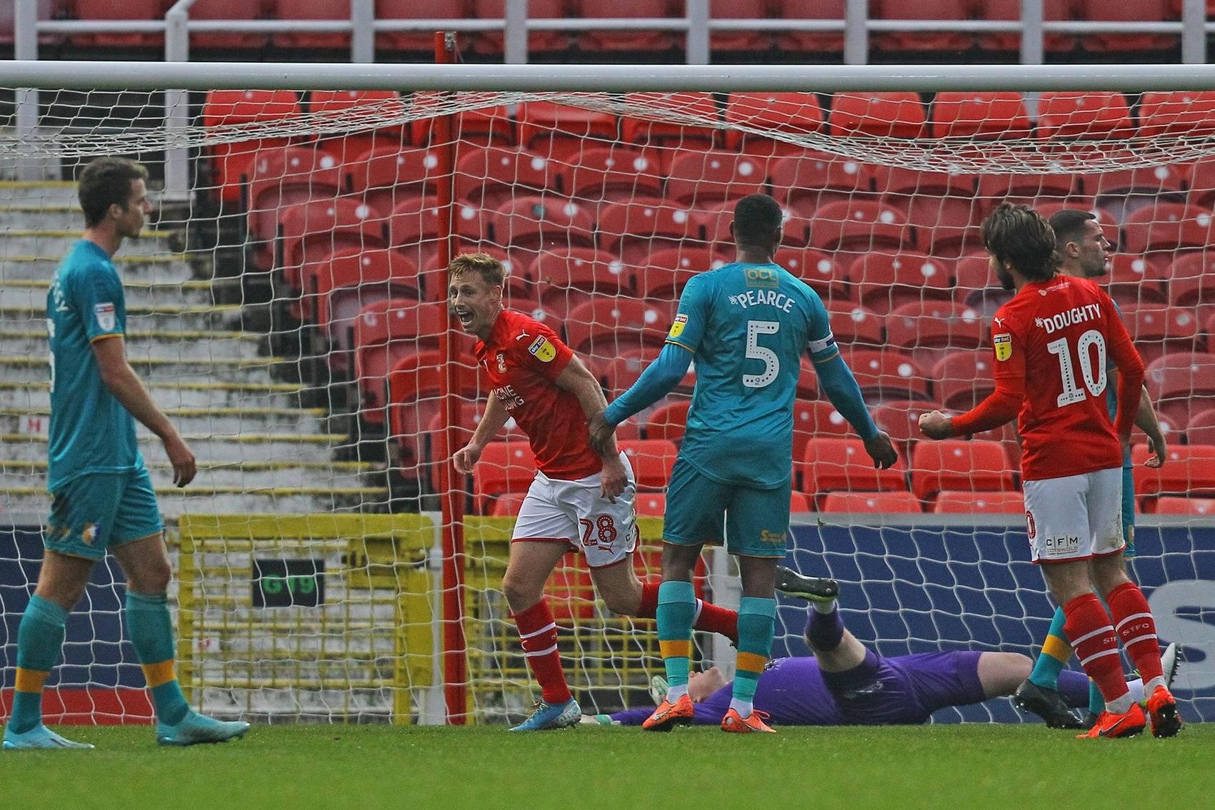 Eoin Doyle celebrates after giving Swindon the lead against Mansfield.