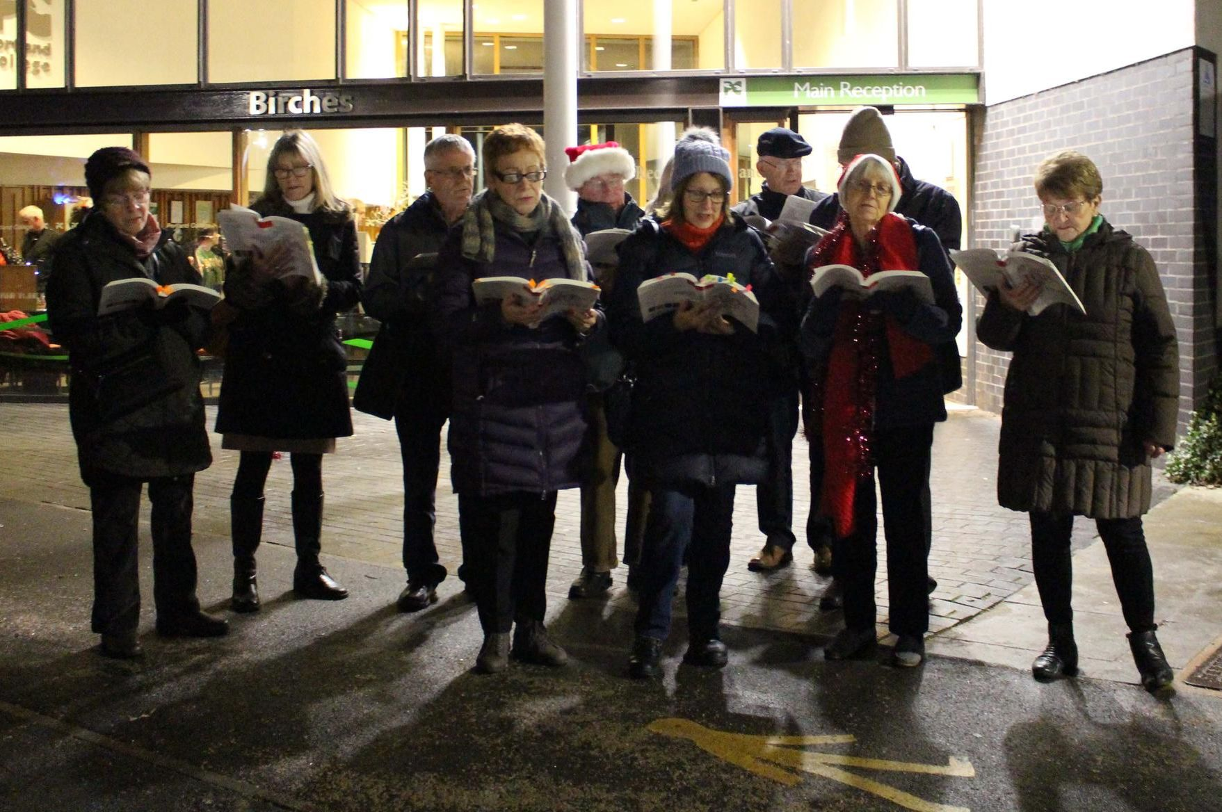 Carol singers at the Portland College lights switch-on.