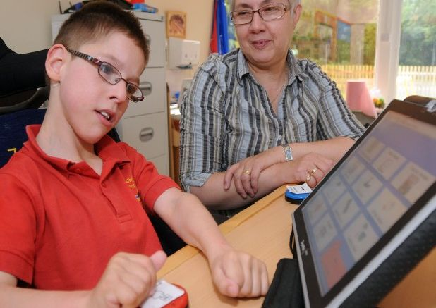 Fountaindale School pupil Kieron Morton gets a helping hand