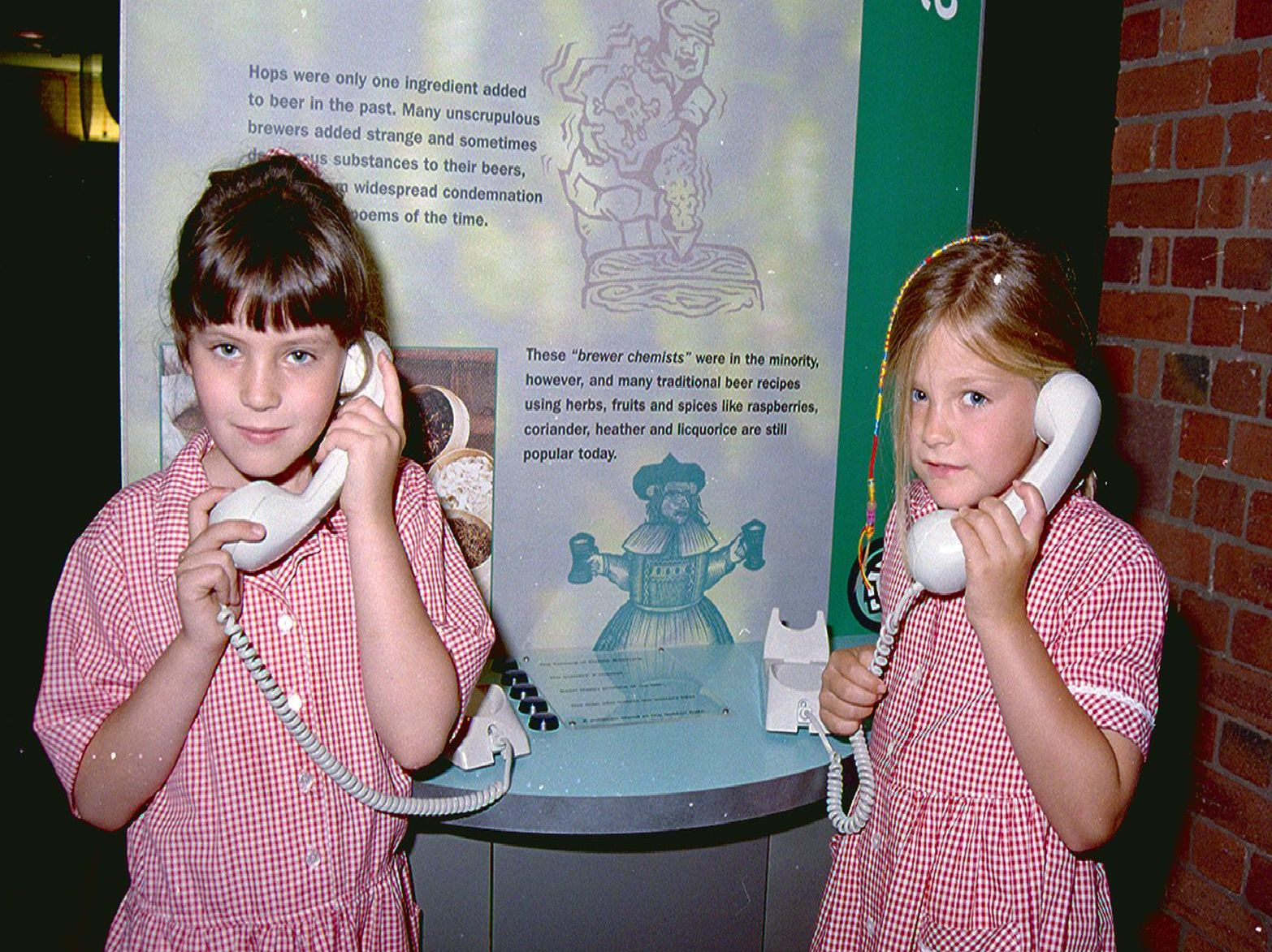 1998: These two school children are enjoying the activities at Mansfields Making It centre. Whos on the telephone?