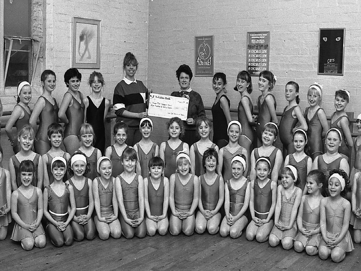 1989: This fabulous group shot features Lisa Gails School of Dance during a cheque presentation. Are you on this picture?