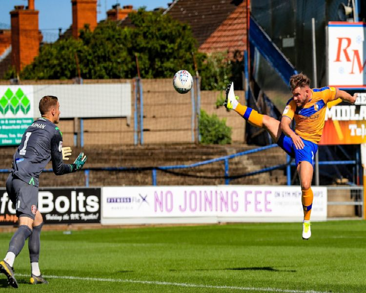 Mansfield's Alex MacDonald with an effort on target.