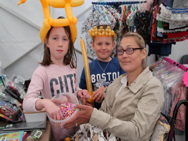 The Boulton family Kelsa-Mae, Finlay and mother Leanna have a go on the Scope tombola.