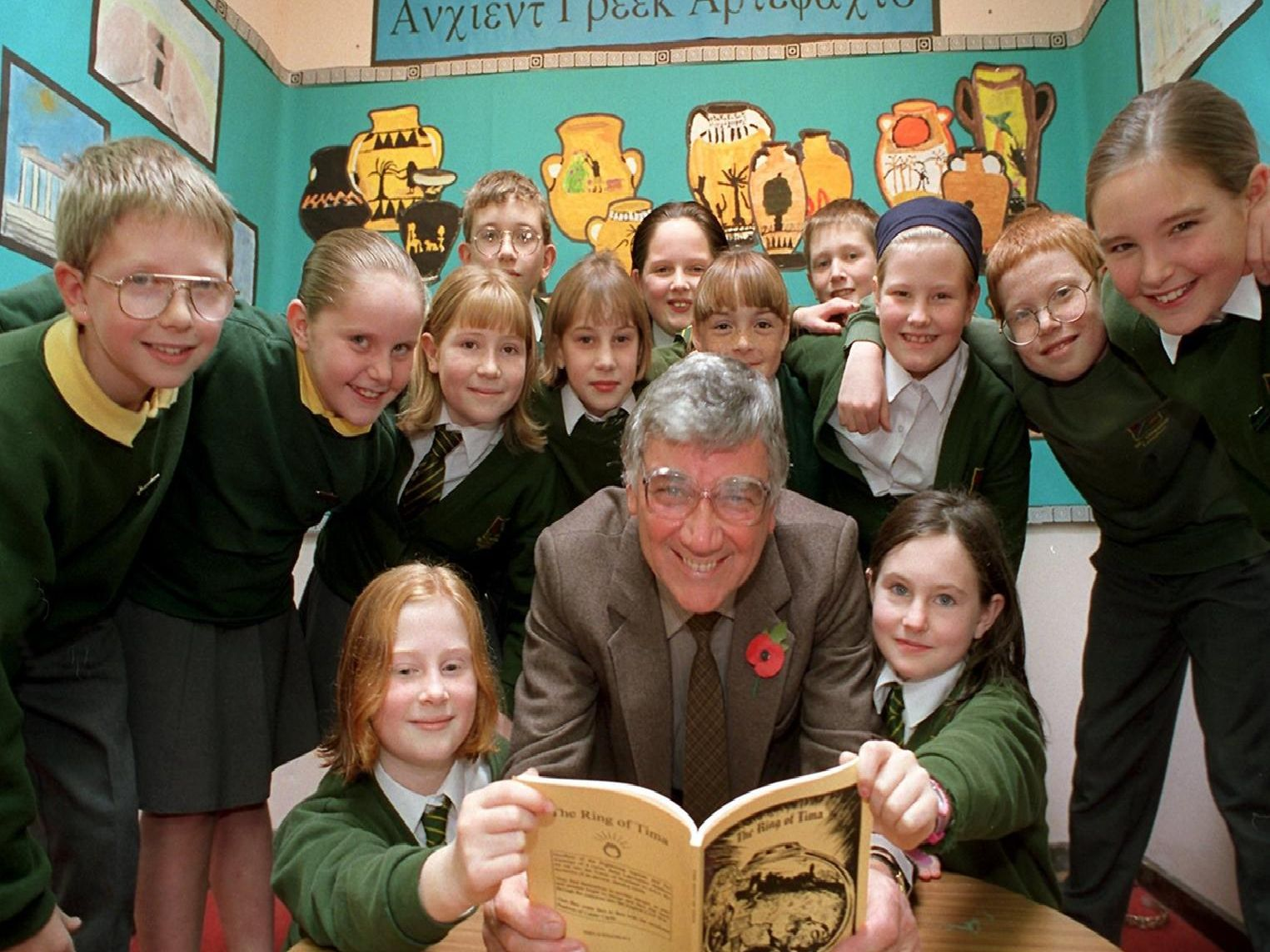 """Author Gerald Rigby reads his book """"The Ring of Tima"""" to year 6 pupils from St Oswald's RC primary school in Longton, near Preston"""