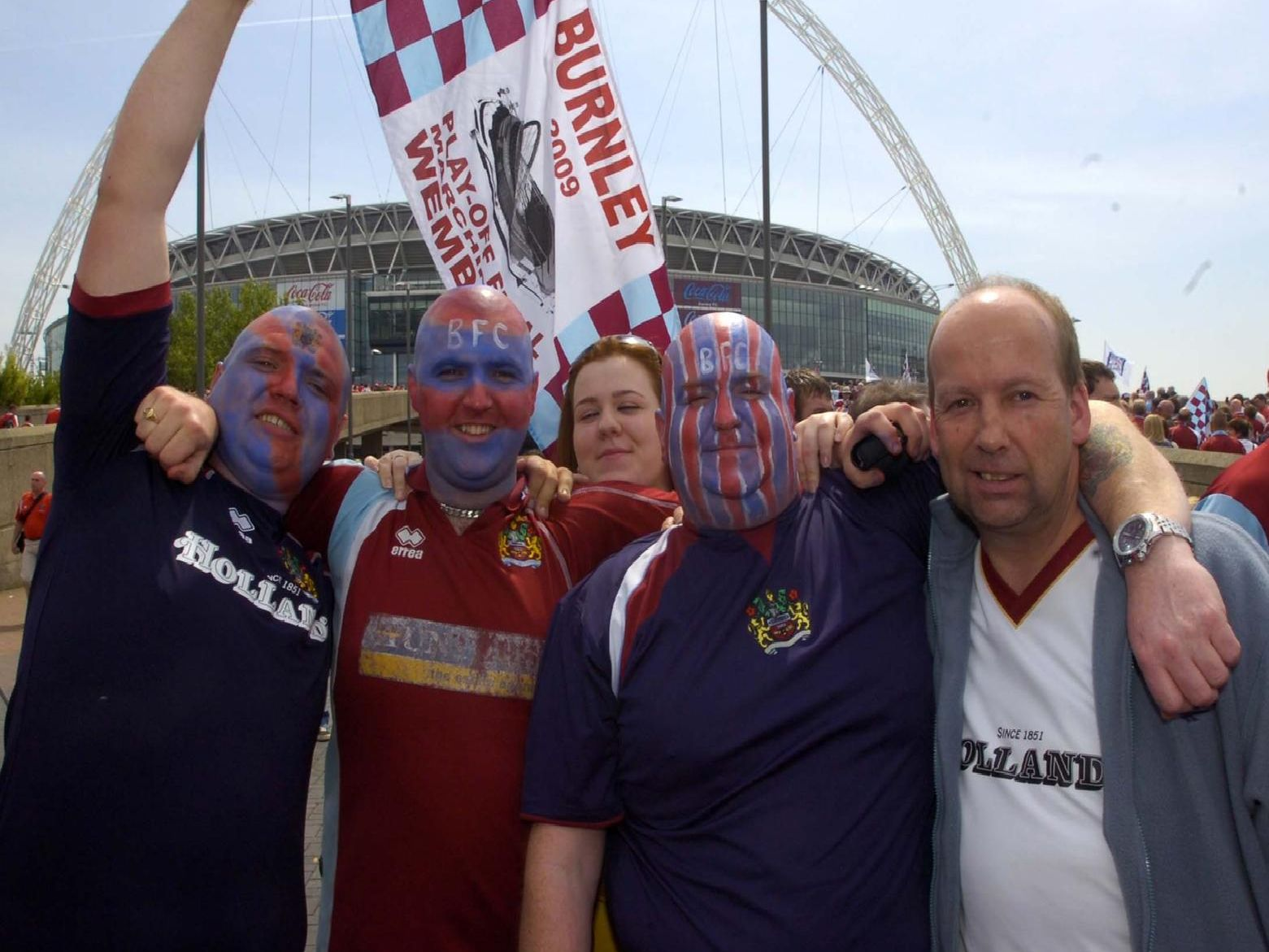 Burnley fans celebrate their side's promotion to the Premier League