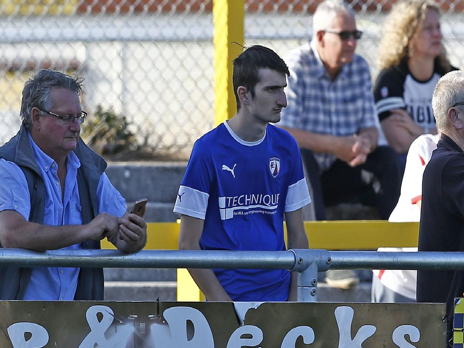 Glum faces as Chesterfield fans take in their 4-0 beating at Sutton United.