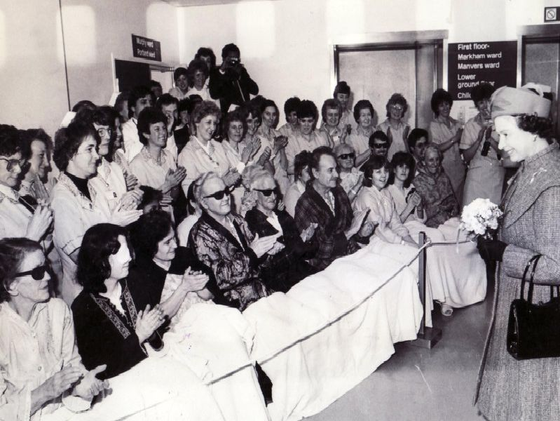 The Queen chats to patients at Chesterfield Royal Hospital where she performed the opening ceremony on March 15, 1985.