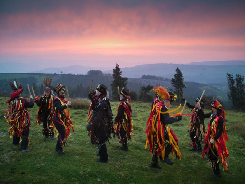 Dancers celebrate as dawn breaks in Derbyshire on May Day.