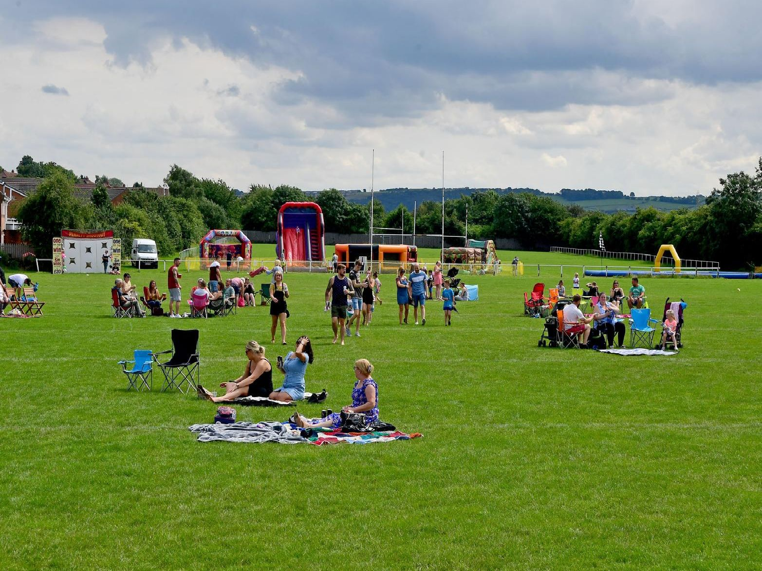 Some of the festival-goers enjoy a sit down before the music starts.