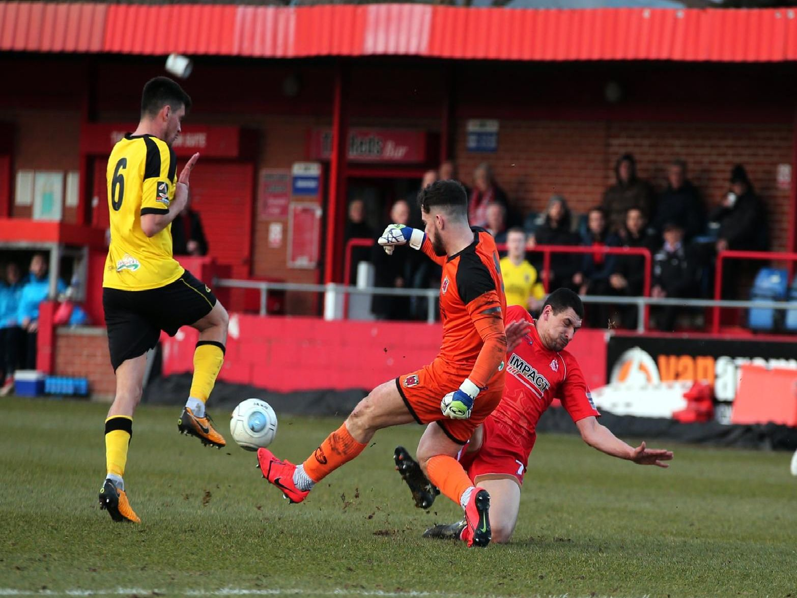 The marurding Danny Clarke is foiled as keeper Matt Urwin wins the race to the ball.