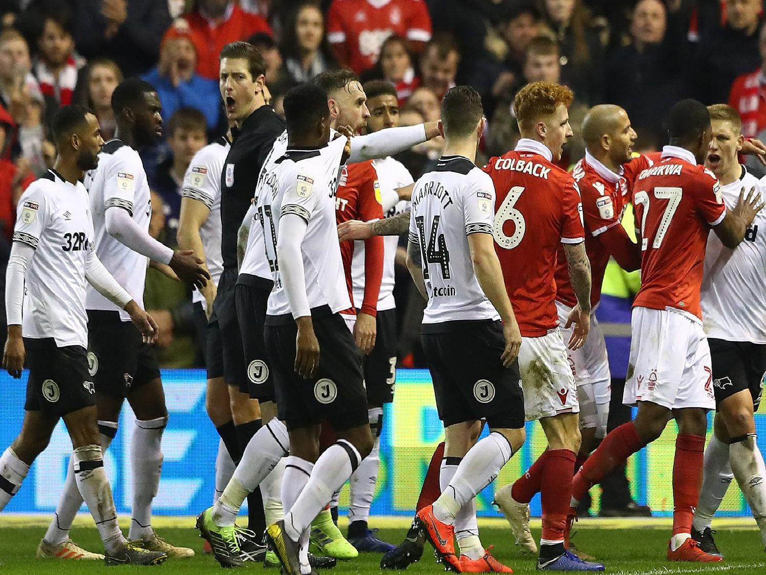 Martyn Waghorn is pulled away by Tendayi Darikwa at the end of the match  between Forest and Derby City Ground on February 25, 2019.