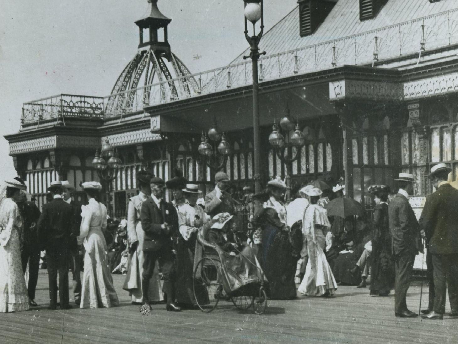 The oldest glass plate photograph dates back to 1897. All turned out to the North Pier in those days and the picture shows crowds in front of the old Indian Pavilion.