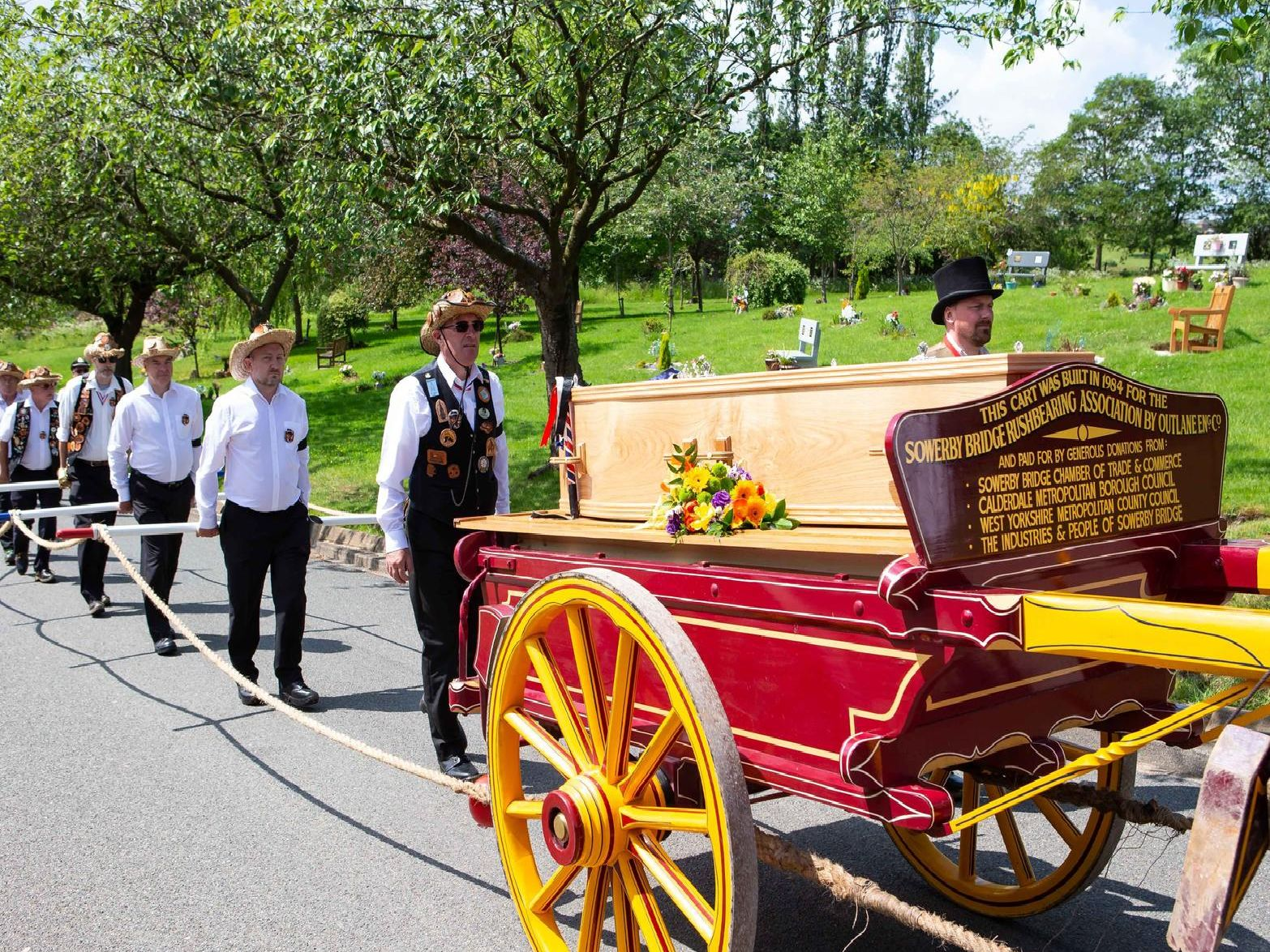 Funeral procession of Fred Knights, by rushbearing cart, for the co-founder and Honorary President of Sowerby Bridge Rushbearing Festival, to Park Wood Crematorium, Elland