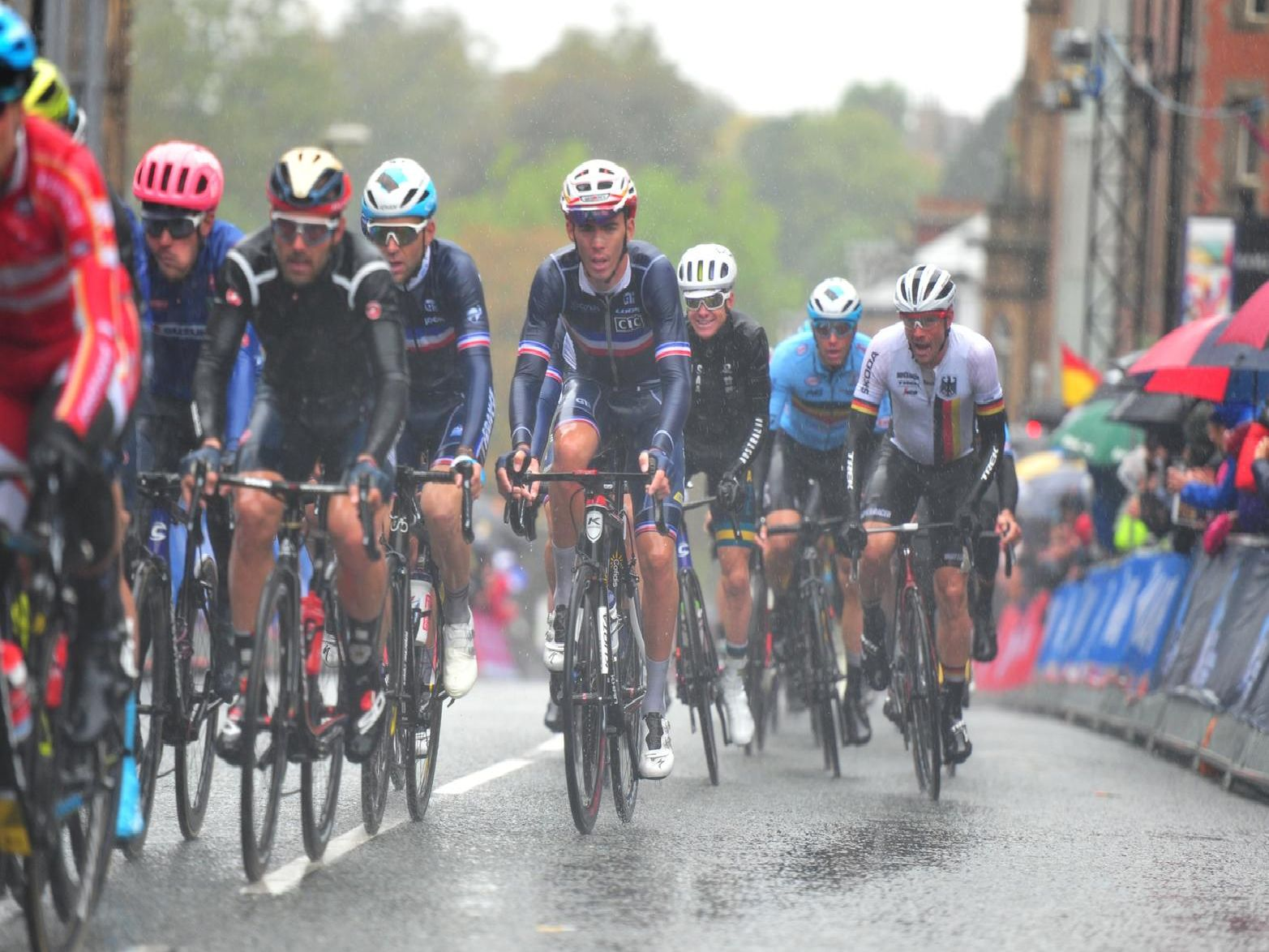 Wet and weary riders make their way up Parliament Street.