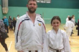 Karate club adds new black belt to their burgeoning ranks