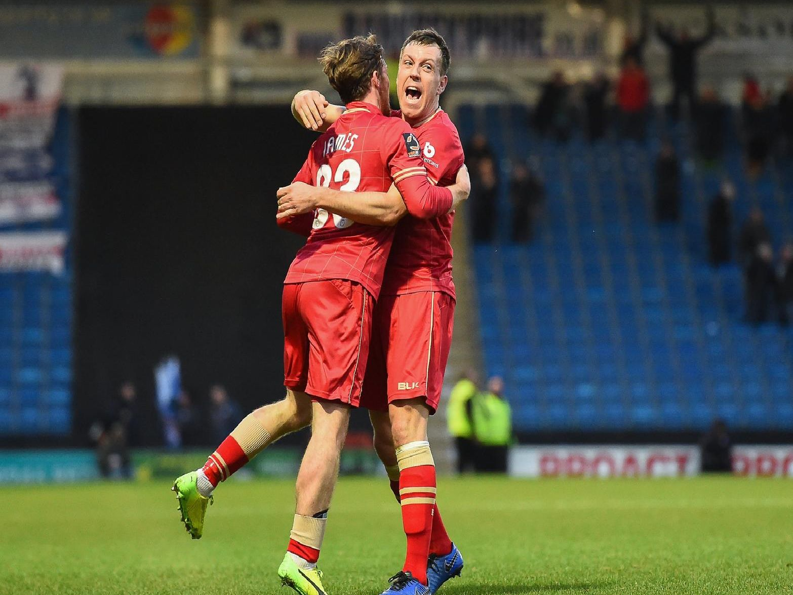 Luke James and Carl Magnay celebrate Hartlepool's goal against Chesterfield.