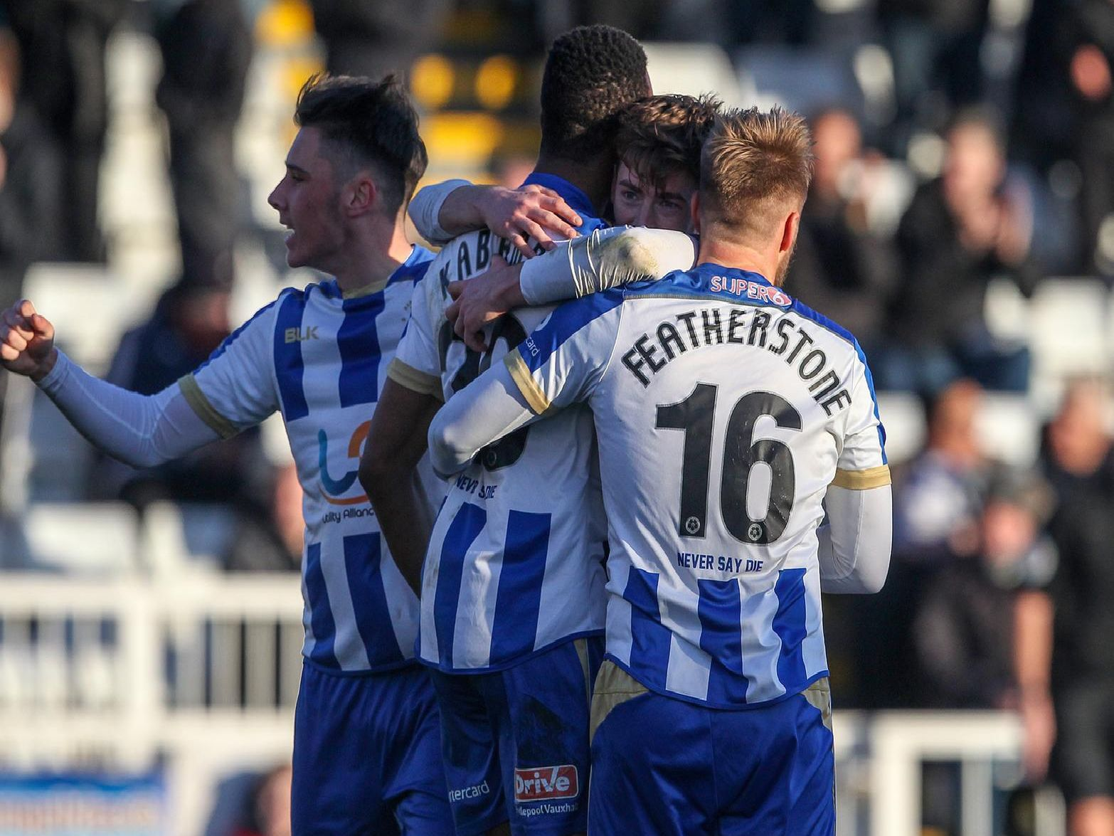 Hartlepool United players celebrate their goal against Leyton Orient.