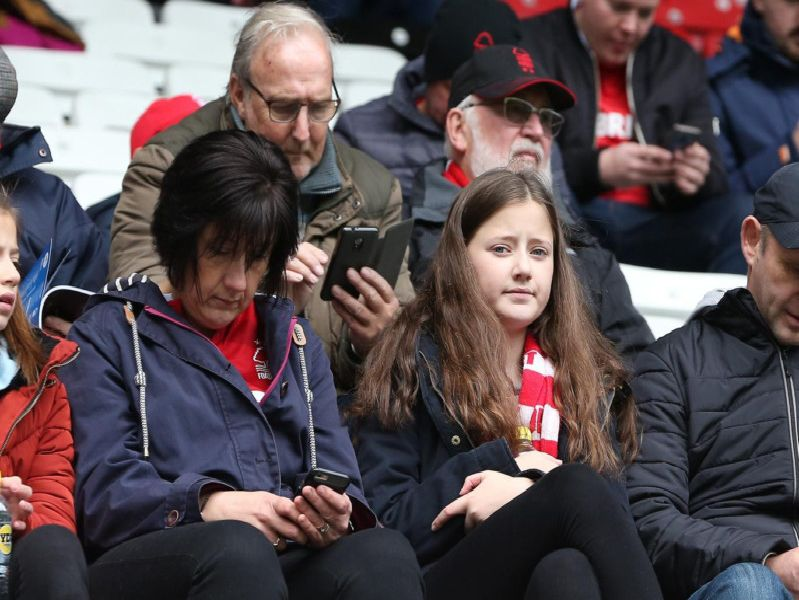 Reds fans pictured at Wigan