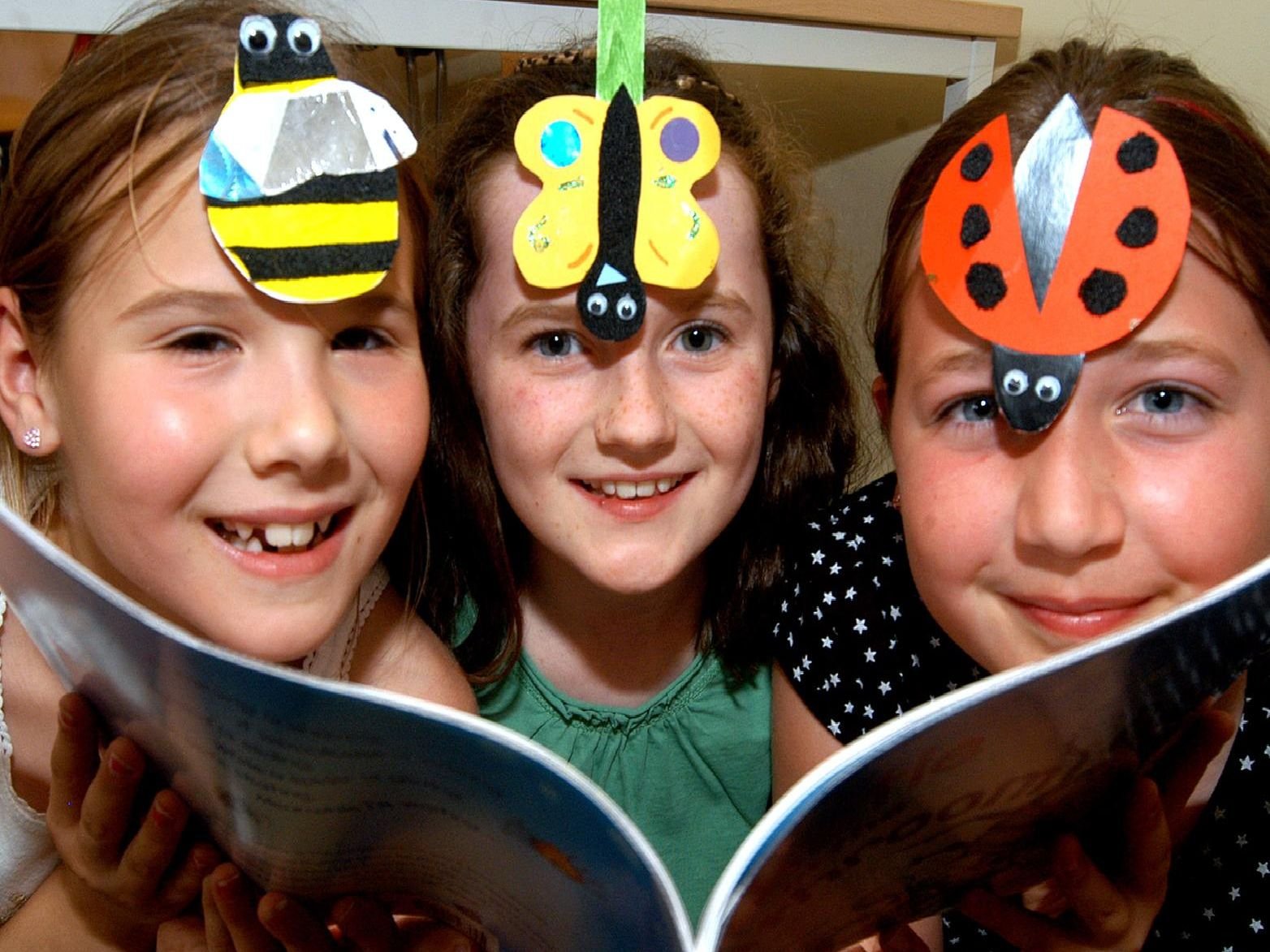 2007: This smiley trio are having fun making bugs and creepy crawlies at the Big Wild Read at Hucknall Library. From the left are: Abbie Wells, Sophie Neal and Abbie Plaskitt.