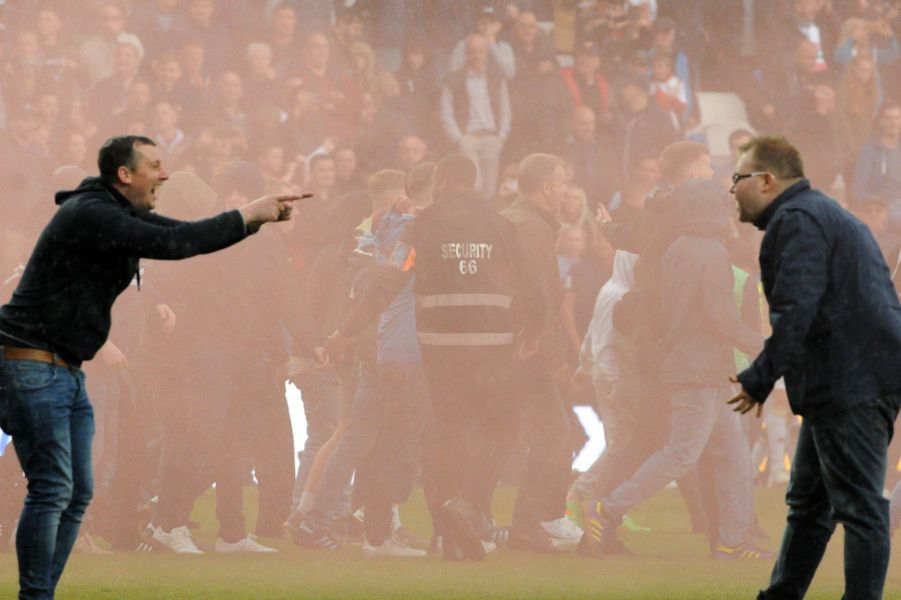 The joy and frustration for opposing fans at the final whistle.