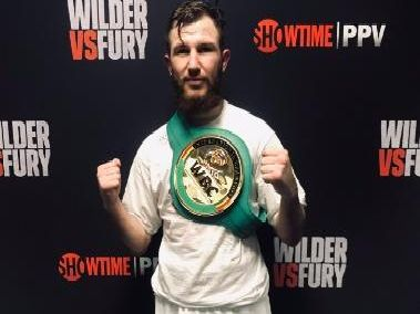 Isaac Lowe celebrates winning the WBC International featherweight title in Los Angeles in December