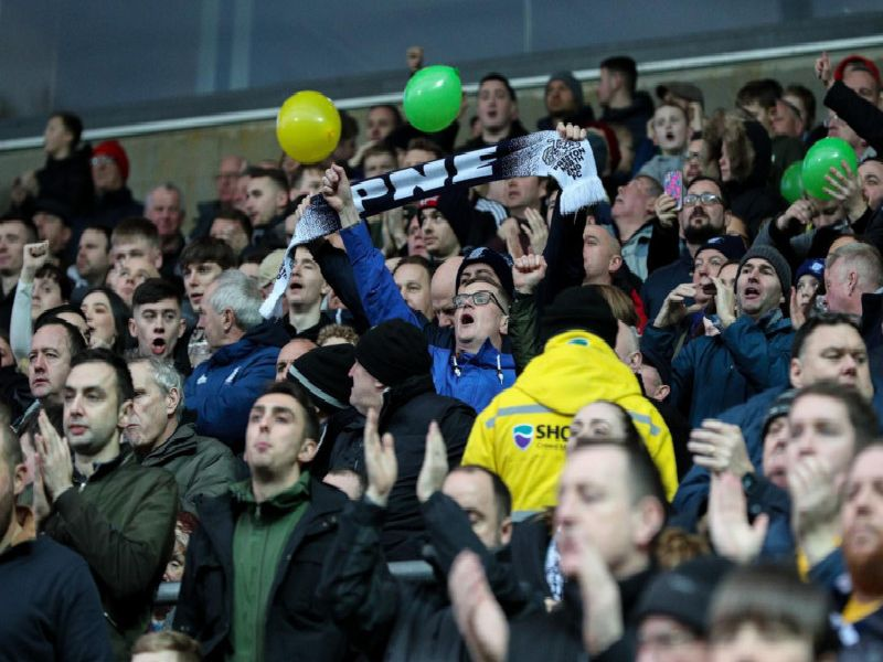 Preston fans cheer their side on at Ewood Park
