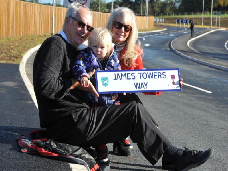 Glynis and David Castle, grandchildren of James Towers, and Chloe Nelson, his great great grandaughter at the opening of the road in his memory