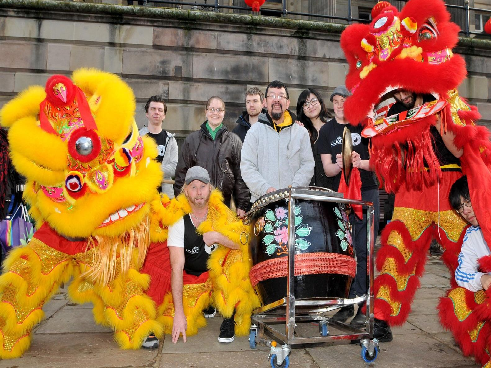 Lion dancers strike a pose on the Flag Market