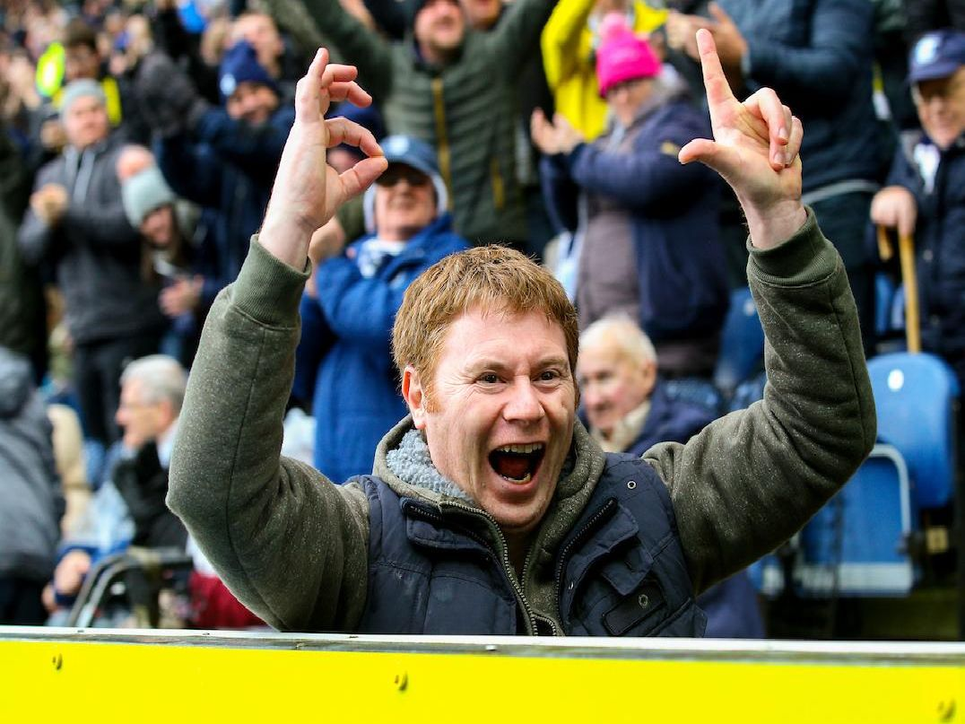 A Preston fan reminds the Blackburn supporters of the score