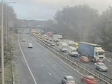 The M6 northbound exit slip road at junction J25 in Wigan remains closed after a fire broke out a timber yard close to the carriageway this morning (March 18).