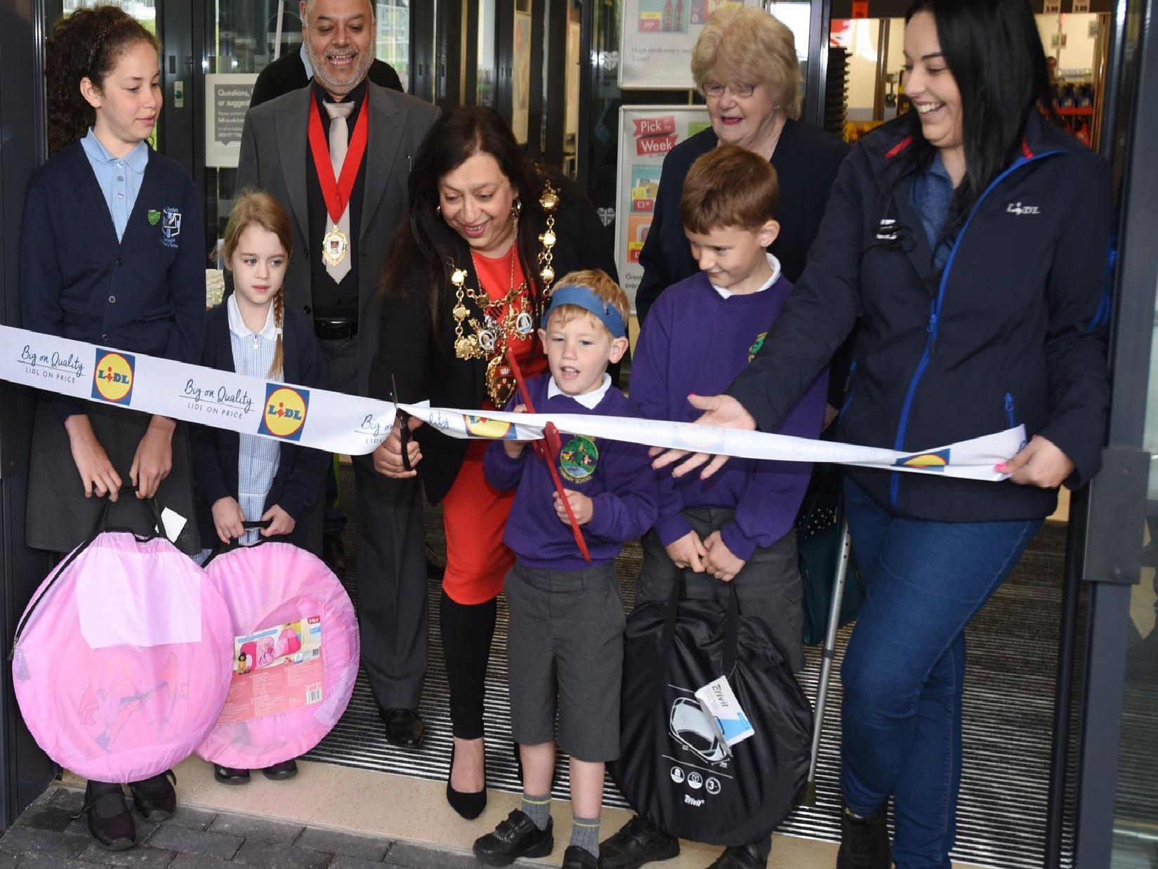 Mayor of Chorley, Coun Hasina Khan, with children from local primary schools and store staff officially opens the new store.