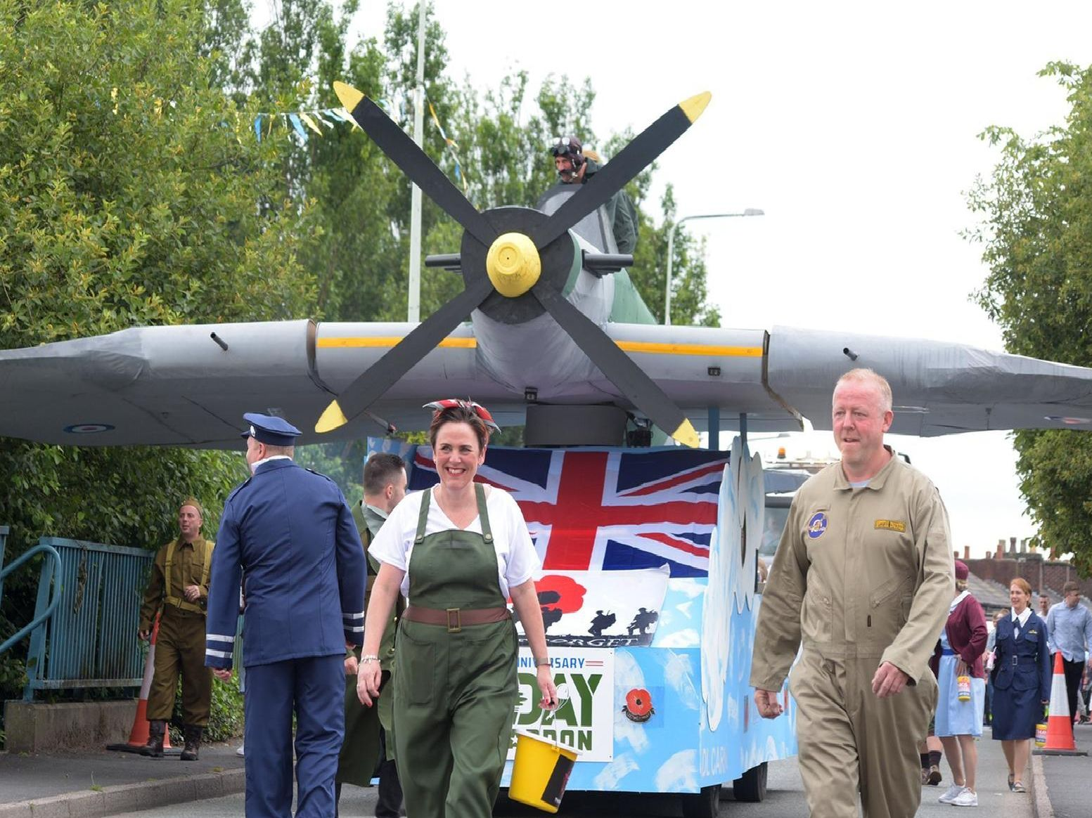 The Gala Group's Spitfire trundles through Adlington as part of the carnival