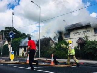 The road is closed after a fire at the Boar's Head in Barton.