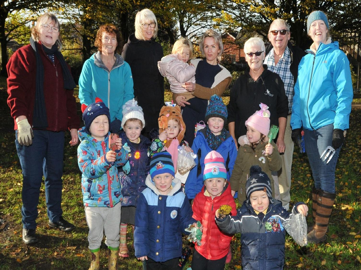 The youngsters took turns to plant bulbs in the green space with help from project organiser Jo Hindle-Taylor and Leyland councillors Ken and Sue Jones