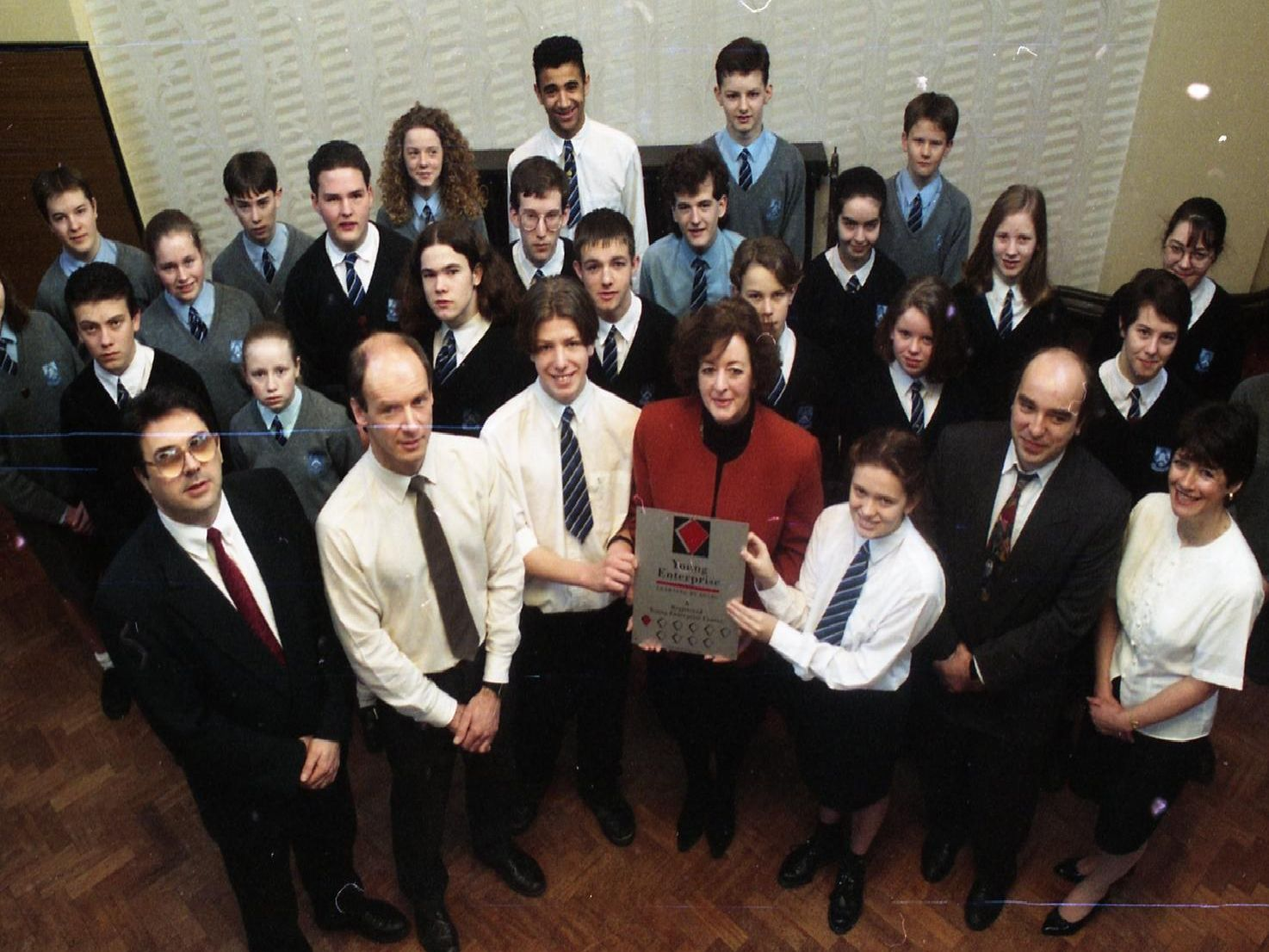 Margaret Malcolm presents a special plaque to Thomas Stadler and Tracey Row of Brownedge St Mary's High School in Bamber Bridge, near Preston, with Phil Murray, Lyell Stott, Martin Walker, Pat Nagle and the Young Enterprise workers. The plaque was presented to reward their efforts during the Young Enterprise scheme
