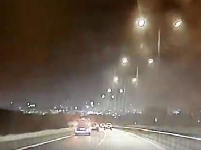 The video has been shared by North West Motorway Police to raise awareness of the dangers of stopping for emergency vehicles in live lanes.