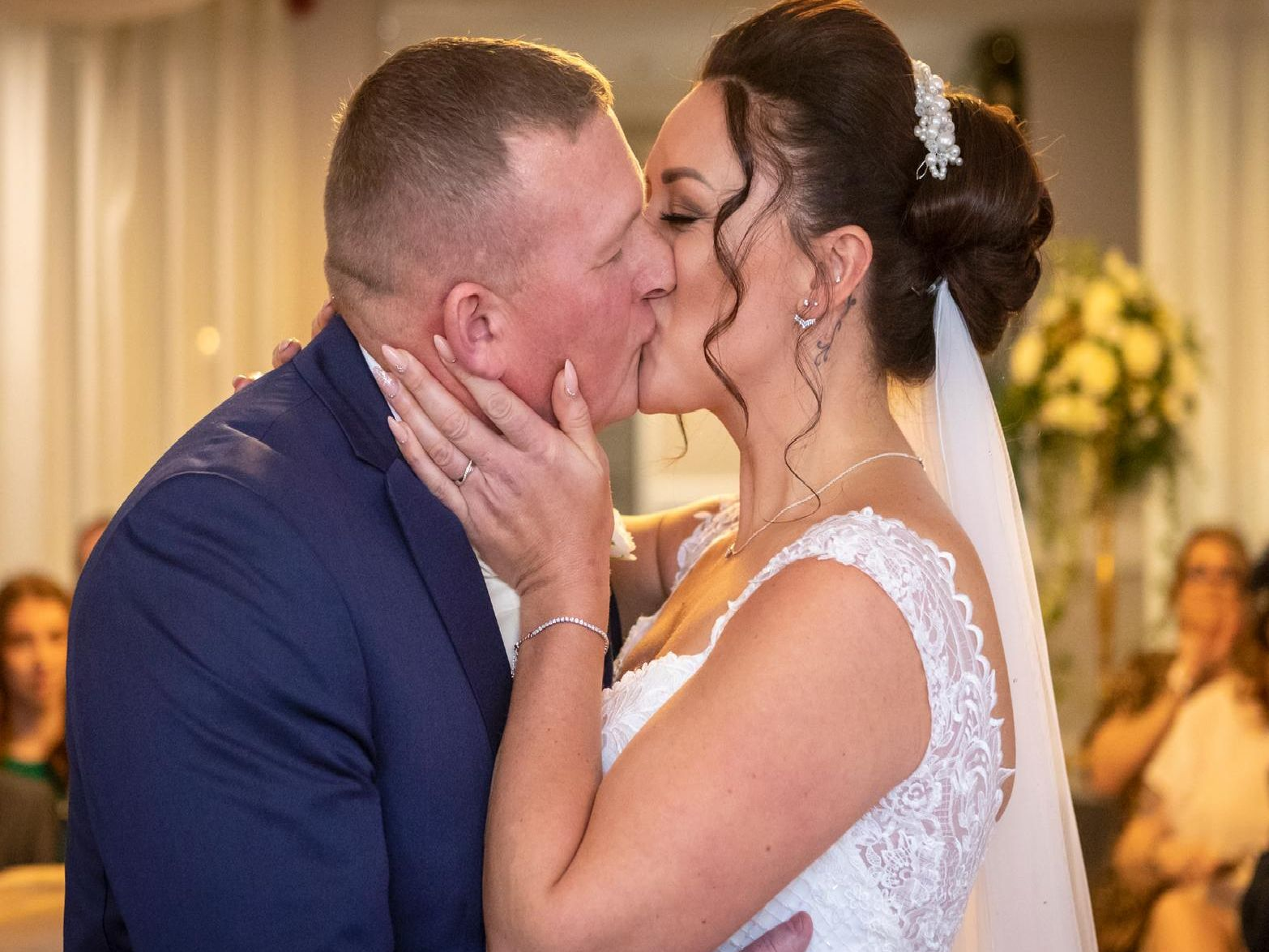 The bride walked down the aisle with her stepdad to Louis Armstrongas What a Wonderful World. It was her late step-grandads favourite song and they were honoured to have the song played in his absence.