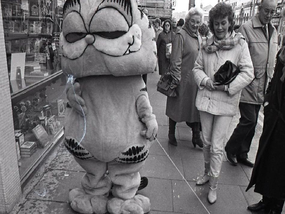 Garfield, aka Ruth Sweeten, 17, whose family own the bookshop of the same name in Fishergate, Preston, hitting the streets to promote more than two dozen Garfield books on sale there