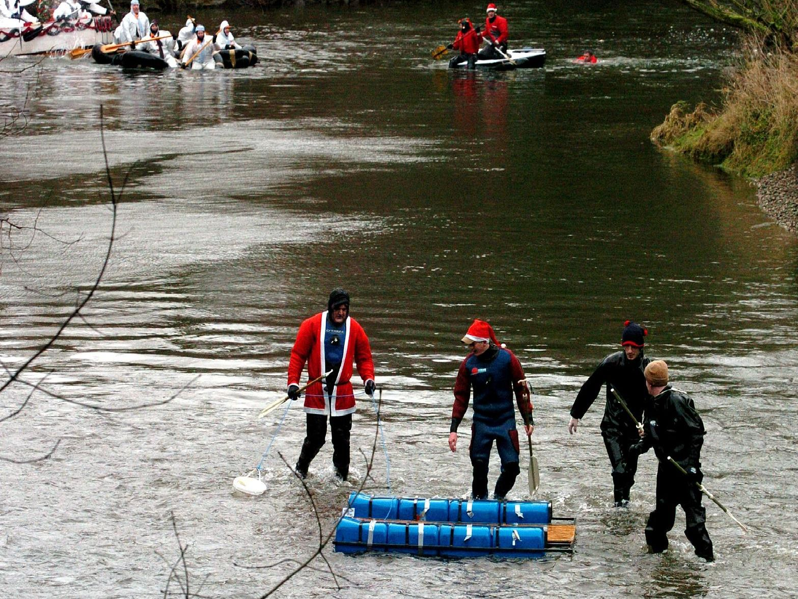 2003: Splashing about in the river, as the annual Boxing Day raft race starts in Matlock and goes down the River Derwent to Cromford, after passing through Matlock Bath.